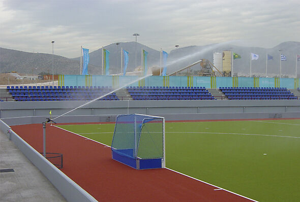 Big Gun Sprinkler watering a field hockey field in Athens, Greece, during the 2004 Olympics.